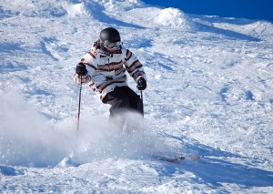 skier skiing down mountain in snow covered Lake Tahoe
