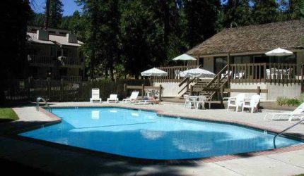 View of pool and poolside seating on a sunny day at Kings Run