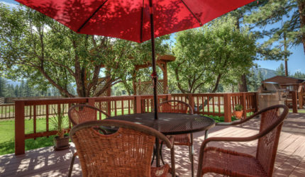 Porch shaded by trees at 9751 Martis Rd home