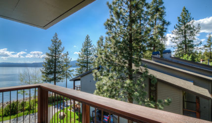 Lakefront home with a balcony view of the lake on Brockway Springs
