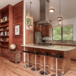 View of Kitchen island and hallway with hardwood floors at 600 Rawhide Dr