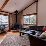 Family room with potbelly stove and a view of tahoe on Squaw Valley Rd. #6