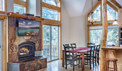 View of Dining Room stone fireplace with tv above the fire place at North Lake Blvd
