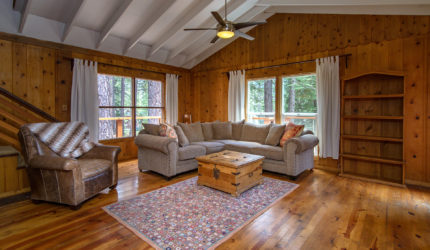 sold listing showing a spacious family room with hardwood floors and walls and white ceiling