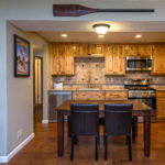 Dining room and kitchen view of hardwood floor and real wood cabinets on lake forest road in tahoe