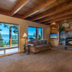 Sitting room with fireplace and view of lake tahoe on huckleberry lane