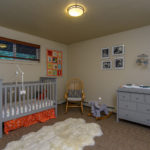 baby's room with carpeted floor