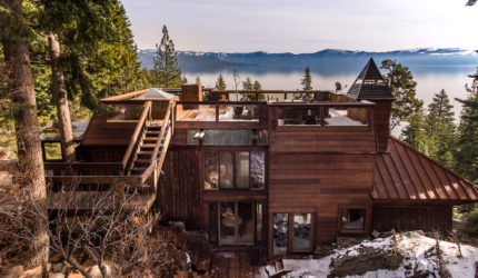 Exterior view of wood cabin's roof and view of lake tahoe