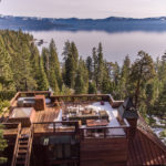 Arial view of outdoor grill and seating on roof overlooking lake tahoe