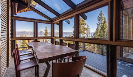 Glass enclosed balcony with view of lake tahoe