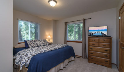 Carpeted bedroom with queen size bed