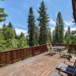Balcony overlooking pine trees