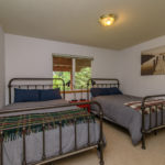 Carpeted bedroom with two beds